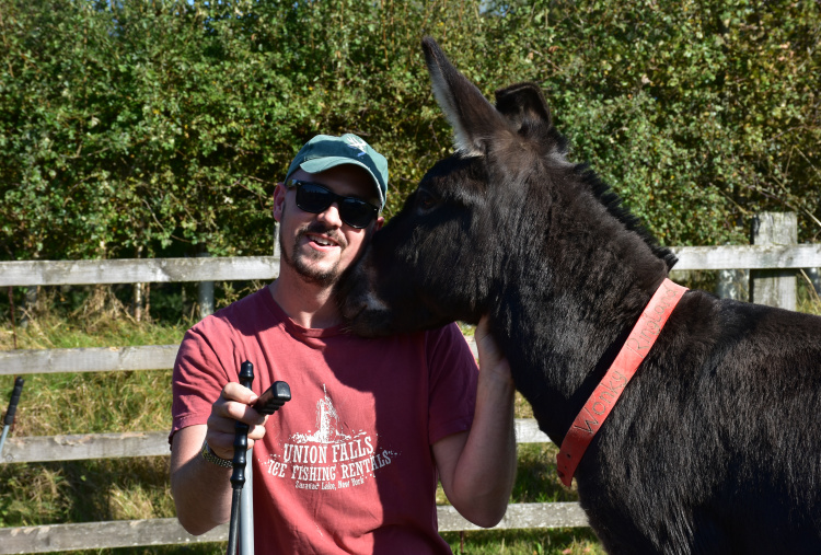 Wildlife and conservation volunteer with donkey