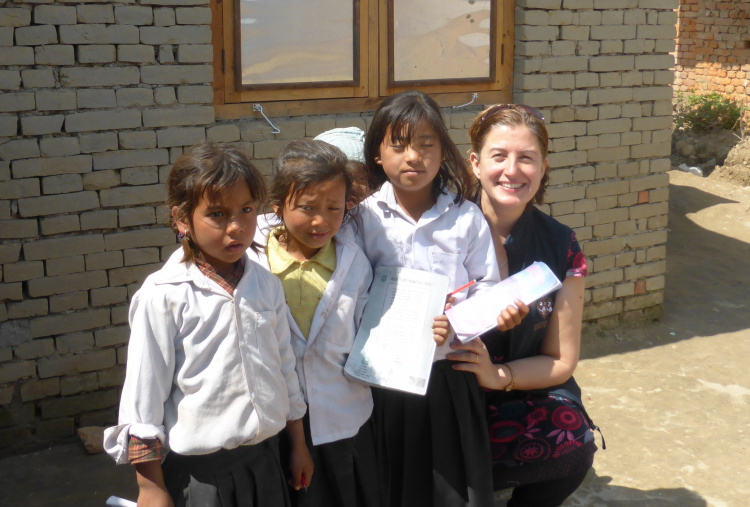Three school girls with a The Donkey Sanctuary staff member
