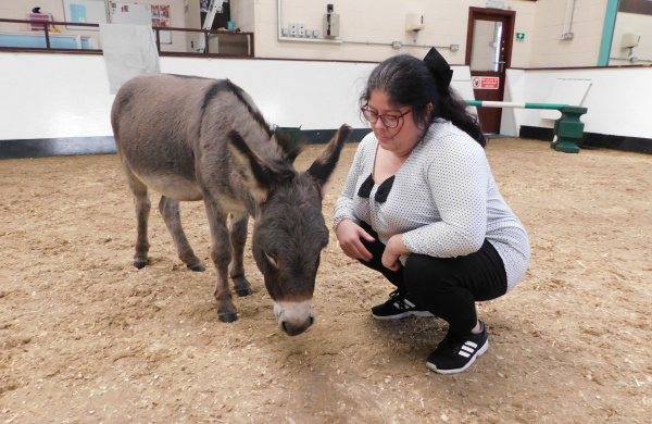 Gillian during a donkey-assisted therapy session