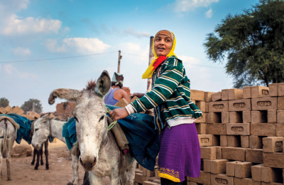 Brick kiln worker and donkey