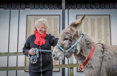a legacy supporter with Zebedee the donkey